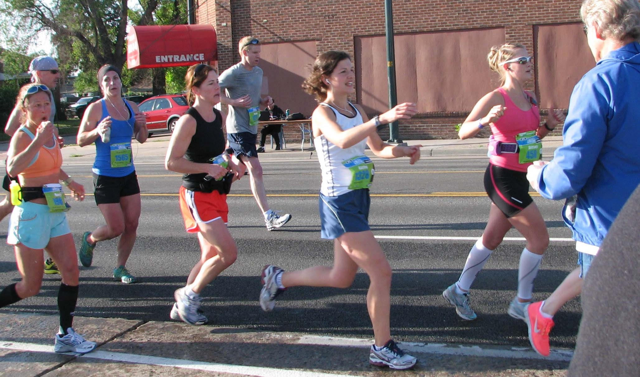 WeCAN members hand out water to Colfax Marathon runners